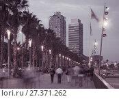 Купить «Illuminated quay in Barcelona with blurred people», фото № 27371262, снято 27 августа 2017 г. (c) Яков Филимонов / Фотобанк Лори
