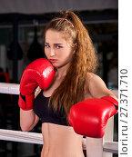 Купить «Sport girl boxing wearing red gloves concept.», фото № 27371710, снято 30 сентября 2015 г. (c) Gennadiy Poznyakov / Фотобанк Лори