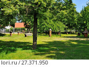 Купить «Museum of Agriculture in Ciechanowiec, Podlaskie voivodeship, Poland. Wooden cottages, garden, mill, church and other devices used to use by Pollish farmers.», фото № 27371950, снято 19 марта 2019 г. (c) age Fotostock / Фотобанк Лори