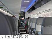 Купить «Interior cabin of a passenger plane», фото № 27380450, снято 13 сентября 2017 г. (c) Алексей Кузнецов / Фотобанк Лори