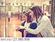 Купить «Mother and daughter enjoying expositions of previous centuries», фото № 27380906, снято 23 февраля 2018 г. (c) Яков Филимонов / Фотобанк Лори