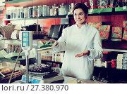 Купить «Seller weighing on scales cake in confectionery store», фото № 27380970, снято 24 января 2017 г. (c) Яков Филимонов / Фотобанк Лори