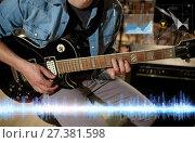 Купить «close up of musician playing guitar at studio», фото № 27381598, снято 18 августа 2016 г. (c) Syda Productions / Фотобанк Лори