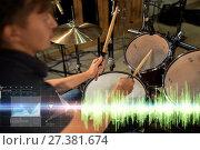Купить «male musician playing drum kit at concert», фото № 27381674, снято 18 августа 2016 г. (c) Syda Productions / Фотобанк Лори
