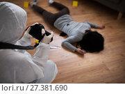 Купить «criminalist photographing dead body at crime scene», фото № 27381690, снято 5 мая 2017 г. (c) Syda Productions / Фотобанк Лори