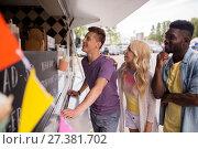 Купить «happy customers queue or friends at food truck», фото № 27381702, снято 1 августа 2017 г. (c) Syda Productions / Фотобанк Лори