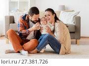 Купить «happy family with baby having fun at home», фото № 27381726, снято 29 сентября 2017 г. (c) Syda Productions / Фотобанк Лори