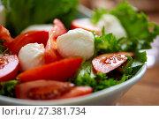 Купить «close up of vegetable salad with mozzarella», фото № 27381734, снято 5 октября 2017 г. (c) Syda Productions / Фотобанк Лори