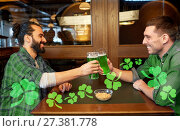 Купить «male friends drinking green beer at bar or pub», фото № 27381778, снято 22 апреля 2015 г. (c) Syda Productions / Фотобанк Лори