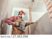 Купить «worker with demolition hammer breaking interior wall», фото № 27383098, снято 8 декабря 2017 г. (c) Дмитрий Калиновский / Фотобанк Лори