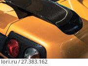 Купить «Car aerodynamics carbon spoiler and rear lights», фото № 27383162, снято 6 ноября 2017 г. (c) EugeneSergeev / Фотобанк Лори