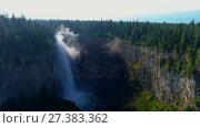 Купить «Beautiful water fall through forest cliff on a sunny day 4k», видеоролик № 27383362, снято 19 июля 2019 г. (c) Wavebreak Media / Фотобанк Лори