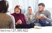 Купить «Portrait of happy family enjoying conversation over cup of coffee at home», видеоролик № 27385422, снято 20 декабря 2017 г. (c) Яков Филимонов / Фотобанк Лори