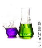 Купить «Beaker and retort with green and blue with a chemical reagent. Chemical experiment with Laboratory glass», фото № 27386354, снято 11 февраля 2016 г. (c) Евгений Ткачёв / Фотобанк Лори