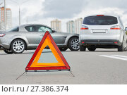 Купить «Accident or crash with two automobile. Road warning triangle sign in focus», фото № 27386374, снято 22 сентября 2013 г. (c) Дмитрий Калиновский / Фотобанк Лори