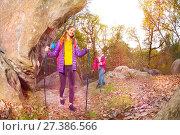 Купить «Happy tourists exploring mountain trails in autumn», фото № 27386566, снято 28 октября 2017 г. (c) Сергей Новиков / Фотобанк Лори