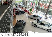 Купить «Selling cars Toyota in the showroom. New products automaker Toyota», фото № 27386614, снято 25 мая 2017 г. (c) Евгений Ткачёв / Фотобанк Лори
