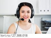 Купить «Woman working in call-center», фото № 27388018, снято 30 марта 2017 г. (c) Яков Филимонов / Фотобанк Лори