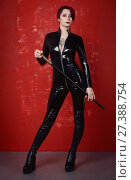 Купить «Beautiful fetish model in latex costume», фото № 27388754, снято 26 октября 2017 г. (c) Дмитрий Черевко / Фотобанк Лори