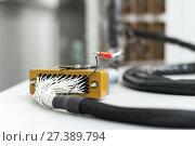 Купить «Fragment of electrical cable with rectangular multi-pin connector.», фото № 27389794, снято 19 октября 2017 г. (c) Андрей Радченко / Фотобанк Лори