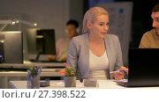Купить «business team with laptop working at night office», видеоролик № 27398522, снято 14 декабря 2017 г. (c) Syda Productions / Фотобанк Лори
