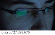 Купить «close up of woman in glasses looking at screen», видеоролик № 27398670, снято 4 января 2018 г. (c) Syda Productions / Фотобанк Лори