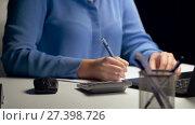 Купить «woman with calculator and laptop at night office», видеоролик № 27398726, снято 4 января 2018 г. (c) Syda Productions / Фотобанк Лори