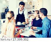 Купить «waiter bringing ordered dishes to friends in tearoom», фото № 27399302, снято 5 июня 2017 г. (c) Яков Филимонов / Фотобанк Лори