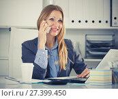Купить «Woman talking on phone in office», фото № 27399450, снято 20 апреля 2017 г. (c) Яков Филимонов / Фотобанк Лори