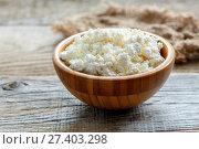 Wooden bowl with cottage cheese. Стоковое фото, фотограф Марина Сапрунова / Фотобанк Лори