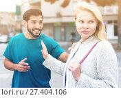 Купить «Husband and wife are emotional quarreling», фото № 27404106, снято 10 августа 2017 г. (c) Яков Филимонов / Фотобанк Лори