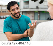 Купить «Female is talking with latino male», фото № 27404110, снято 10 августа 2017 г. (c) Яков Филимонов / Фотобанк Лори