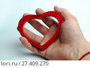 Купить «Heart in hand», фото № 27409270, снято 6 февраля 2017 г. (c) Григорий Алехин / Фотобанк Лори