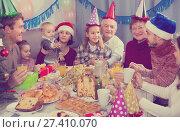 Купить «Smiling family members having celebration», фото № 27410070, снято 25 мая 2018 г. (c) Яков Филимонов / Фотобанк Лори