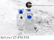Купить «Man in special clothes collecting samples of water potentially contaminated by toxic material, in winter on the lake, in coal mine», фото № 27410510, снято 22 декабря 2017 г. (c) Сергей Тимофеев / Фотобанк Лори