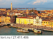 Italy. Venice. Top view of the Castello district, embankment Riva Ca di Dio and Arsenale from the San Marco Channel  in the rays of the setting sun (2016 год). Редакционное фото, фотограф Виктория Катьянова / Фотобанк Лори