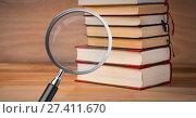 Купить «3D Magnifying glass over books», фото № 27411670, снято 27 апреля 2018 г. (c) Wavebreak Media / Фотобанк Лори