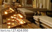 Купить «candles in Catholic church on stands», видеоролик № 27424050, снято 27 ноября 2017 г. (c) BestPhotoStudio / Фотобанк Лори