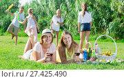 Купить «Two nice mums enjoying picnic outdoors», фото № 27425490, снято 23 августа 2017 г. (c) Яков Филимонов / Фотобанк Лори