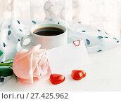 Купить «St Valentines day background in warm pastel tones. Cup of coffee, rose, blank love card and heart shaped candies», фото № 27425962, снято 24 января 2017 г. (c) Зезелина Марина / Фотобанк Лори