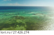 Купить «Aerial view of Bohol coast Island. Aerial. Philippines. Flight high above the sea.», видеоролик № 27426274, снято 21 января 2018 г. (c) Mikhail Davidovich / Фотобанк Лори