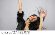 Купить «happy smiling beautiful young woman dancing», видеоролик № 27428078, снято 11 января 2018 г. (c) Syda Productions / Фотобанк Лори
