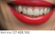 lips or mouth of smiling woman with red lipstick. Стоковое видео, видеограф Syda Productions / Фотобанк Лори