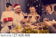 Купить «Family during celebration of New Year», фото № 27428406, снято 17 декабря 2017 г. (c) Яков Филимонов / Фотобанк Лори
