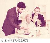 Купить «Employees are demonstrating reports on laptop to mature boss», фото № 27428678, снято 27 июня 2017 г. (c) Яков Филимонов / Фотобанк Лори