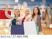 Купить «happy young women with shopping bags in mall», фото № 27460946, снято 3 ноября 2014 г. (c) Syda Productions / Фотобанк Лори