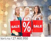 Купить «happy young women with shopping bags in mall», фото № 27460950, снято 3 ноября 2014 г. (c) Syda Productions / Фотобанк Лори