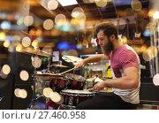 Купить «male musician playing cymbals at music store», фото № 27460958, снято 11 декабря 2014 г. (c) Syda Productions / Фотобанк Лори