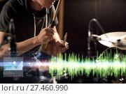 Купить «male musician playing drum kit at concert», фото № 27460990, снято 18 августа 2016 г. (c) Syda Productions / Фотобанк Лори