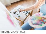 Купить «artist washing paintbrush at art studio», фото № 27461002, снято 1 июня 2017 г. (c) Syda Productions / Фотобанк Лори